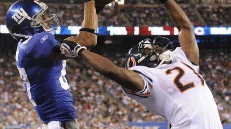 New York Giants wide receiver Domenik Hixon, left,