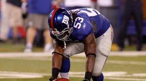 New York Giants' Greg Jones #53 recovers a