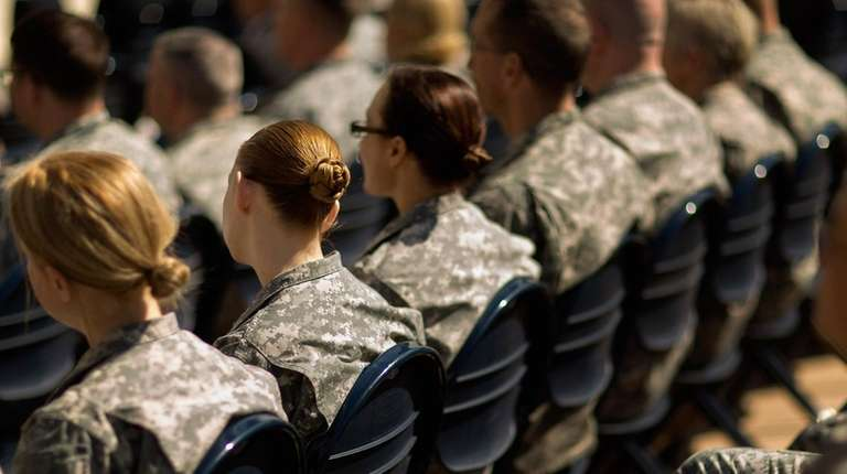 Soldiers, officers and civilian employees attend the commencement