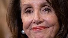 House Speaker Nancy Pelosi, D-Calif., stands at a
