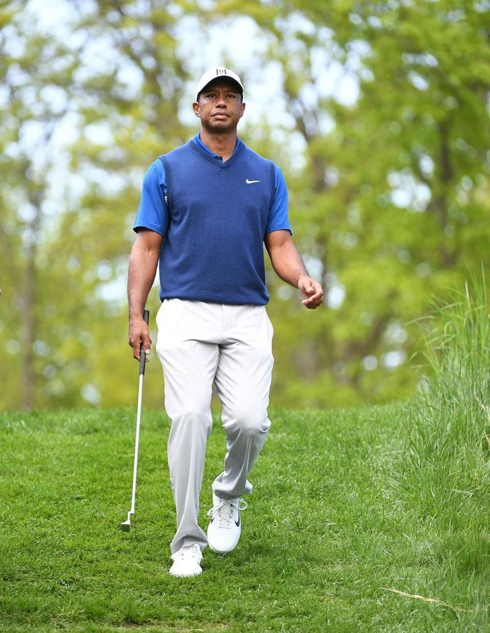 Tiger Woods walks from the 3rd green to