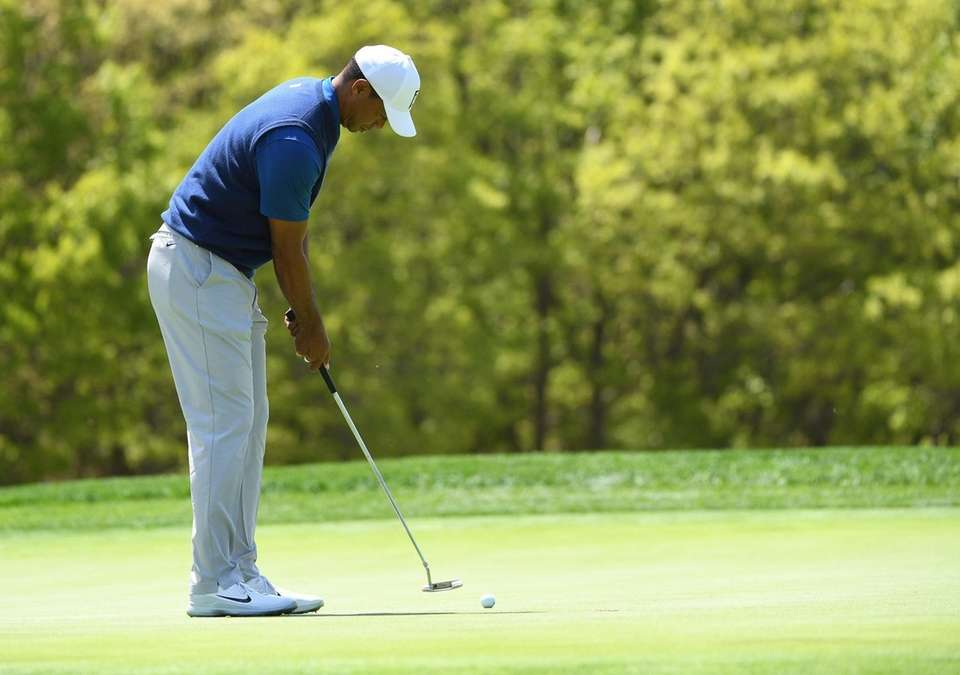 Tiger Woods putts on the 4th green in