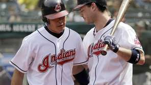 Cleveland Indians' Kosuke Fukudome, left, is congratulated by