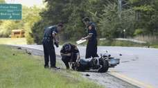 Investigators at the scene of a fatal motorcycle