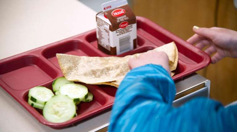 A student eats lunch at William Allen School