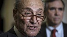 Senate Minority Leader Chuck Schumer speaks to the