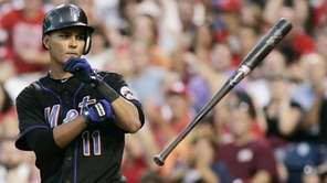 New York Mets Ruben Tejada flings his bat