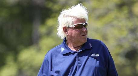 John Daly tries to direct his putt on