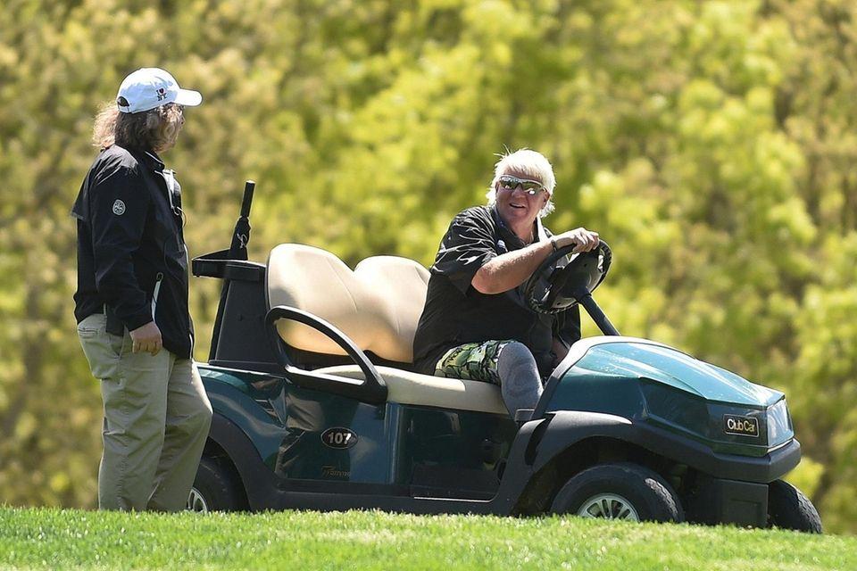 John Daly makes use of a cart between