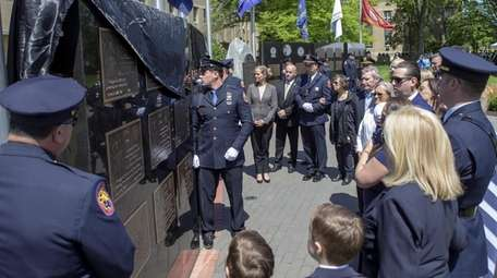 Families of Officers Peter F. Curran and James