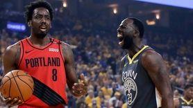 Golden State Warriors' Draymond Green, right, reacts beside