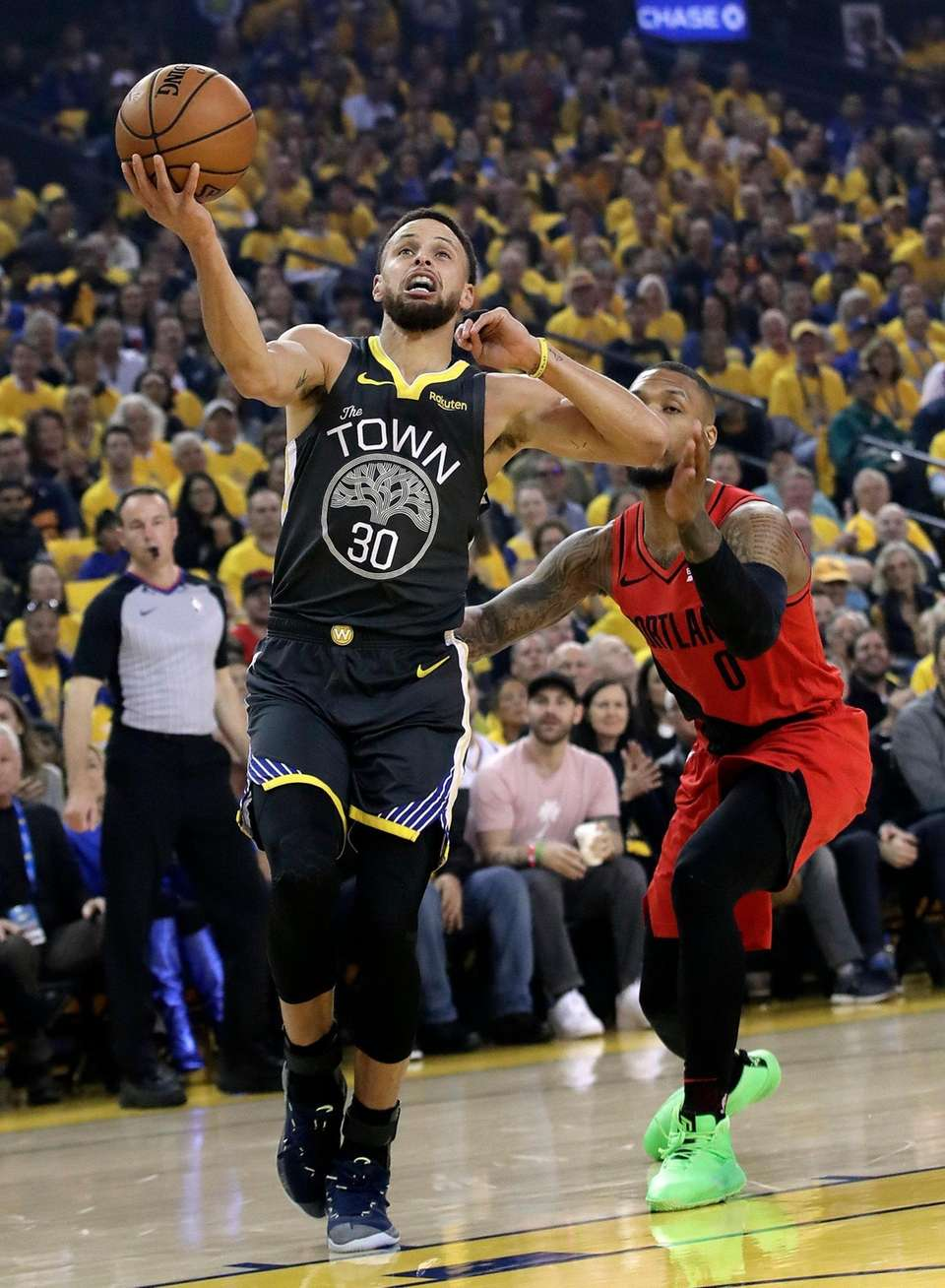 Golden State Warriors' Stephen Curry, left, drives for