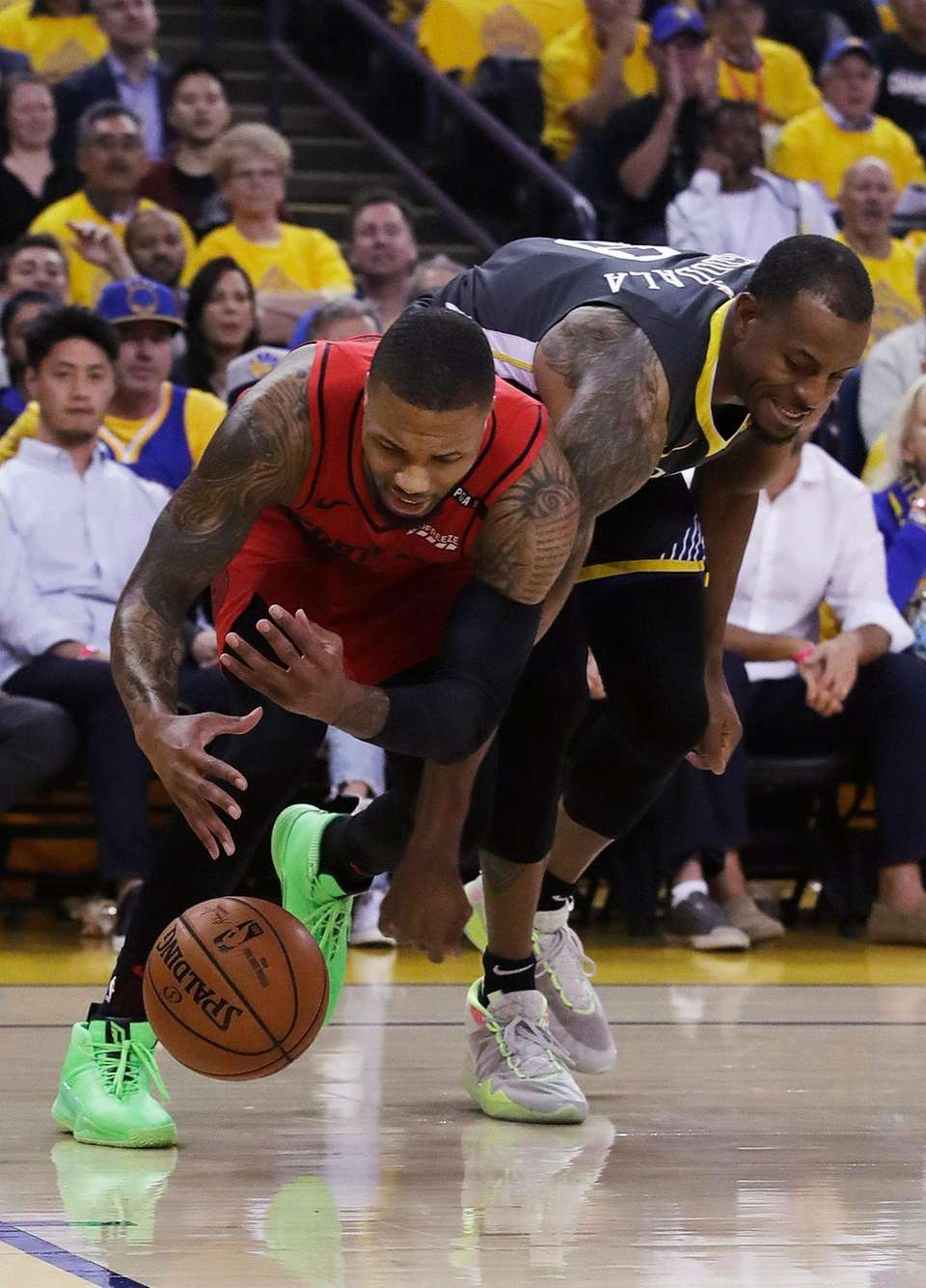 Portland Trail Blazers guard Damian Lillard, left, reaches