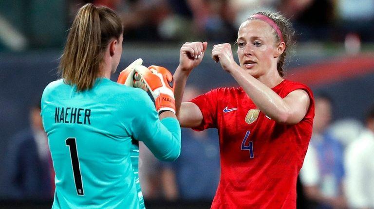U.S. goalkeeper Alyssa Naeher (1) and teammate Becky