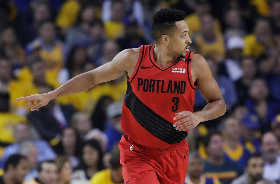 Portland Trail Blazers guard CJ McCollum gestures after