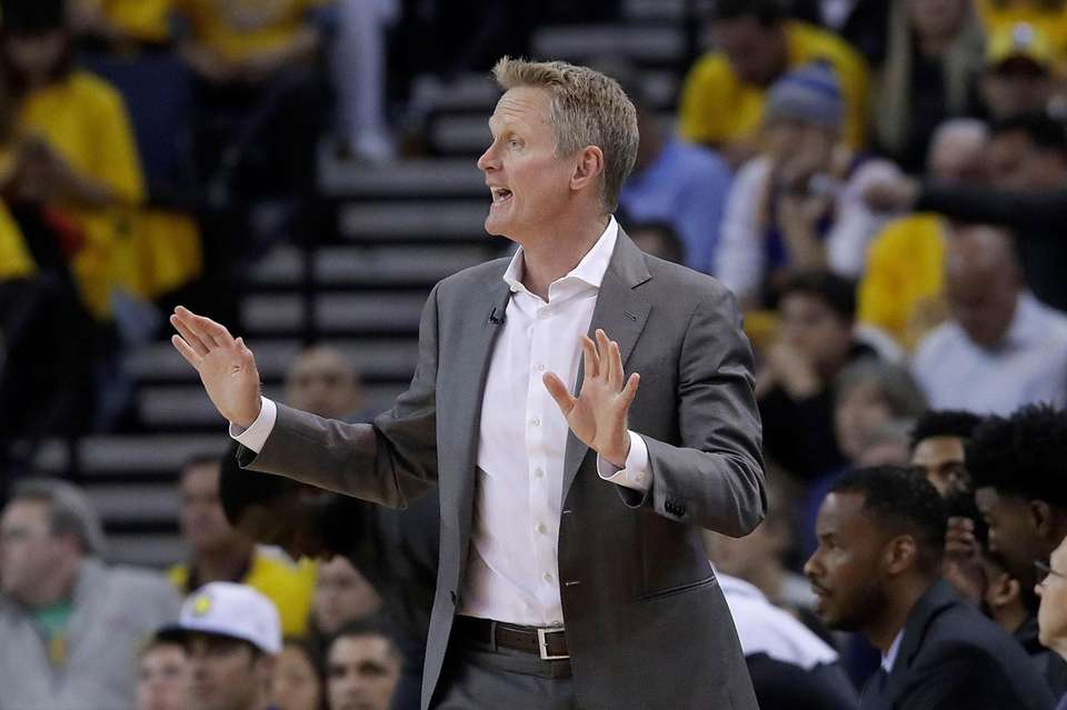 Golden State Warriors coach Steve Kerr gestures during