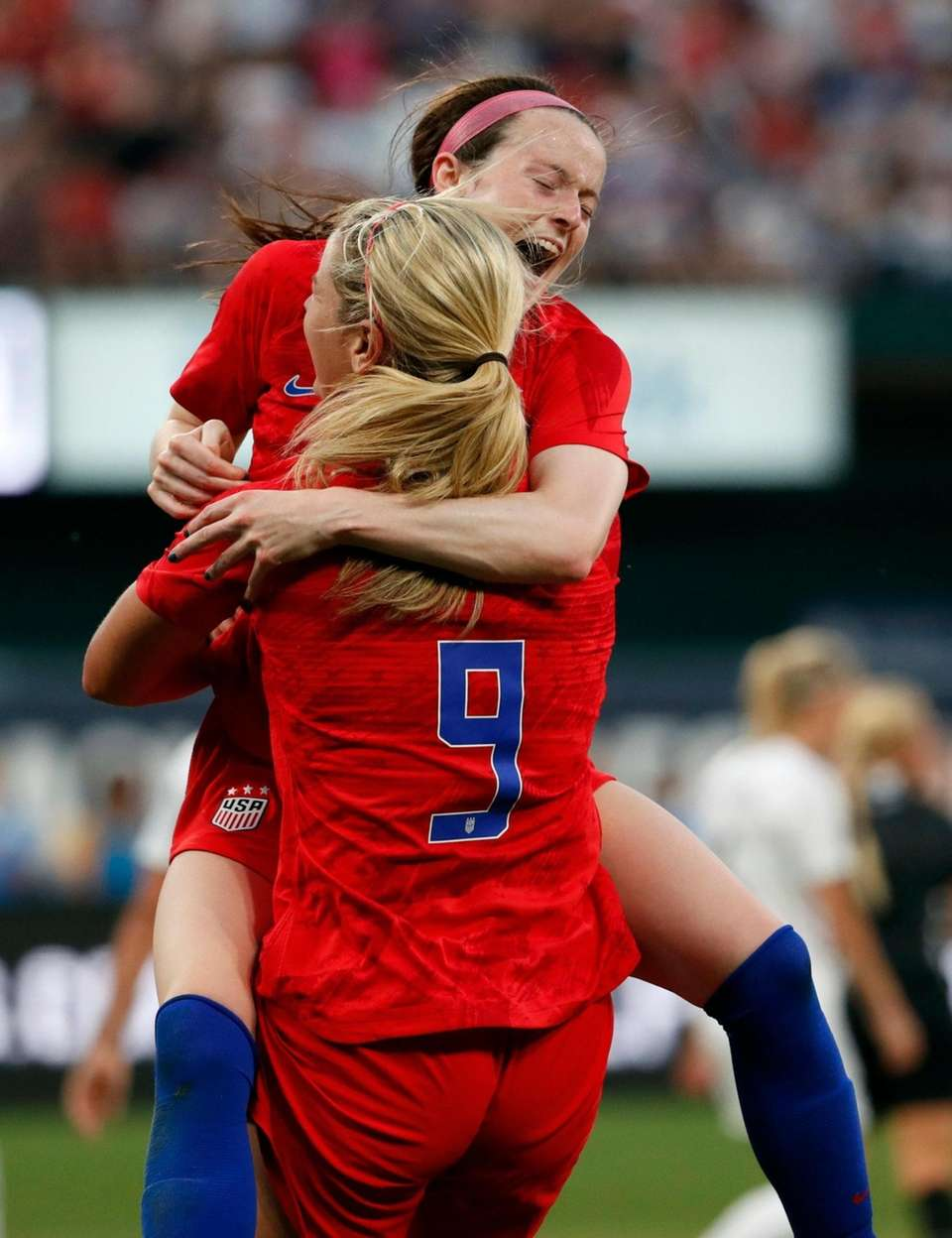 United States' Rose Lavelle is congratulated by Lindsey