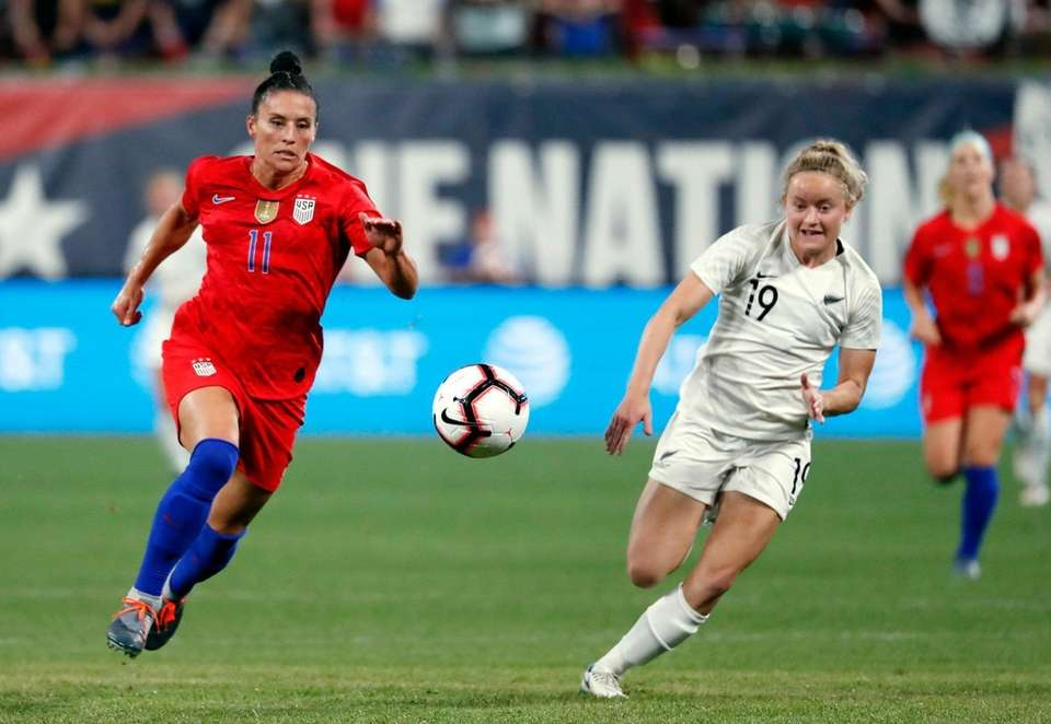United States' Ali Krieger, left, and New Zealand's