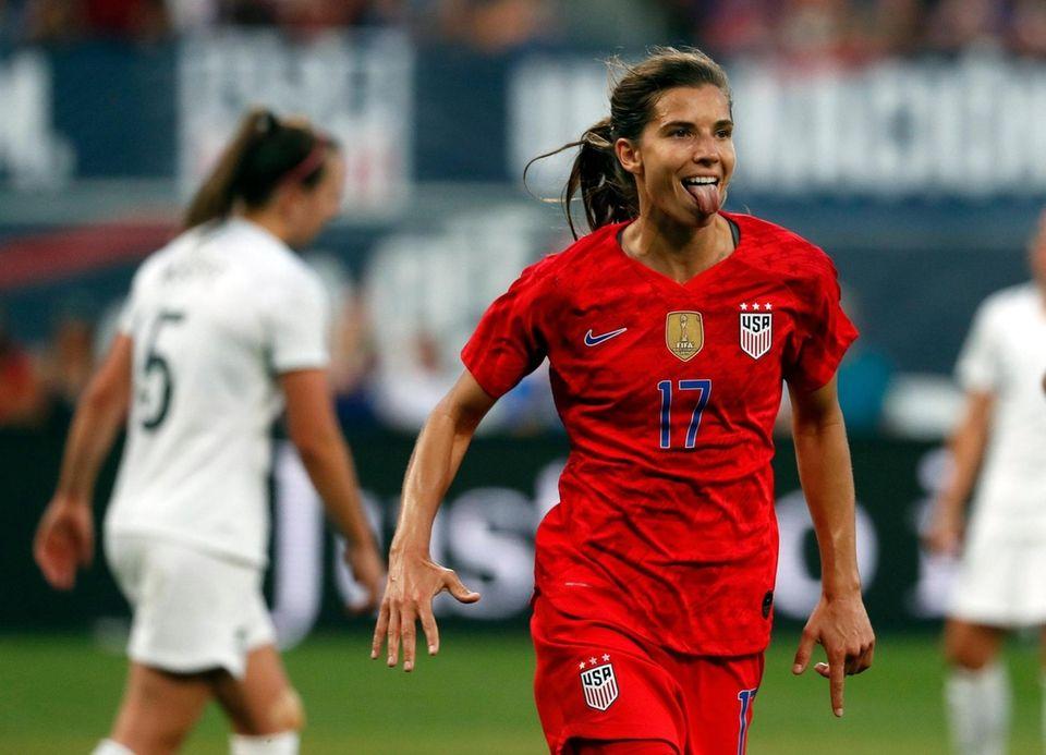 United States forward Tobin Heath, right, celebrates after
