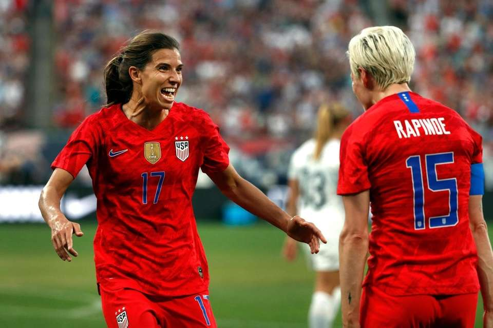 United States' Tobin Heath, left, is congratulated by
