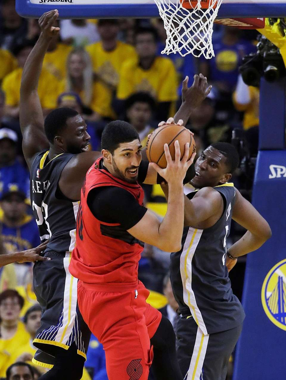 Portland Trail Blazers center Enes Kanter, center, grabs