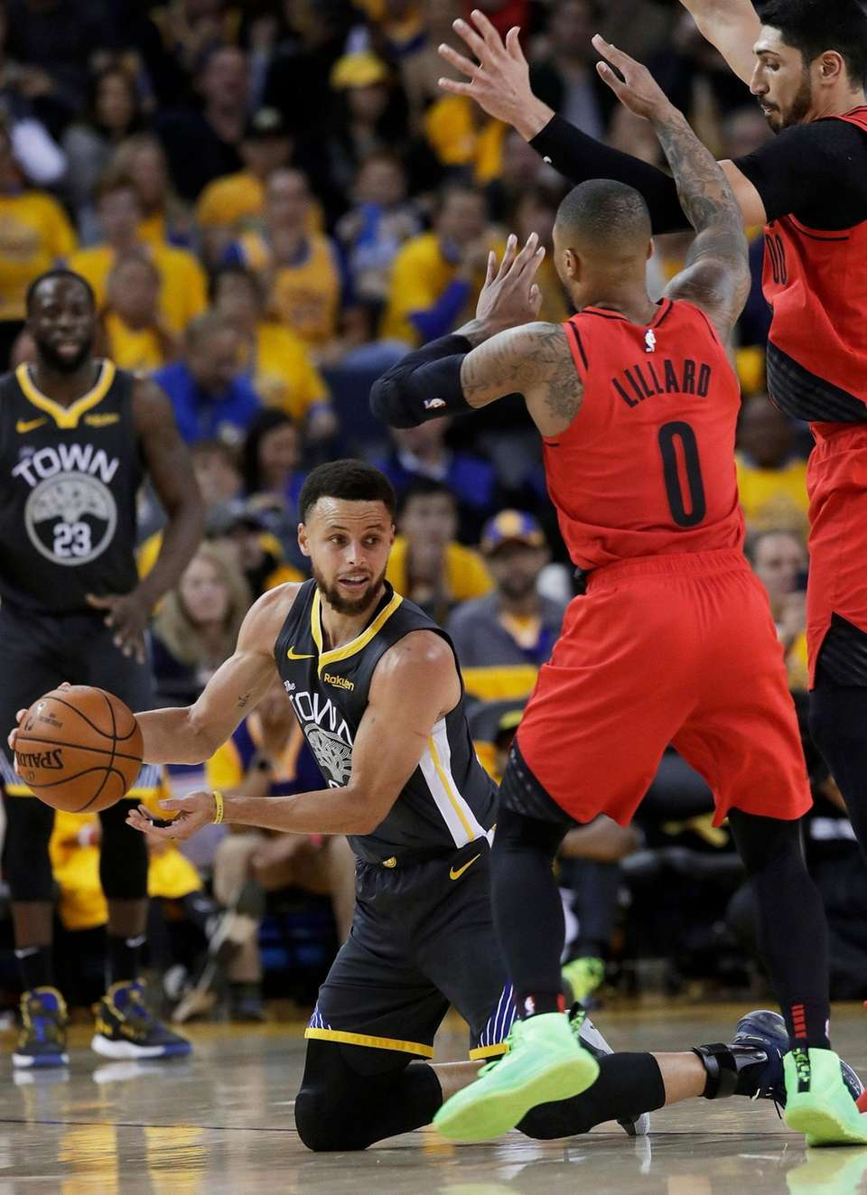 Golden State Warriors guard Stephen Curry, bottom, passes