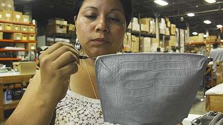 Factory worker Maria Sandobal works on the detail