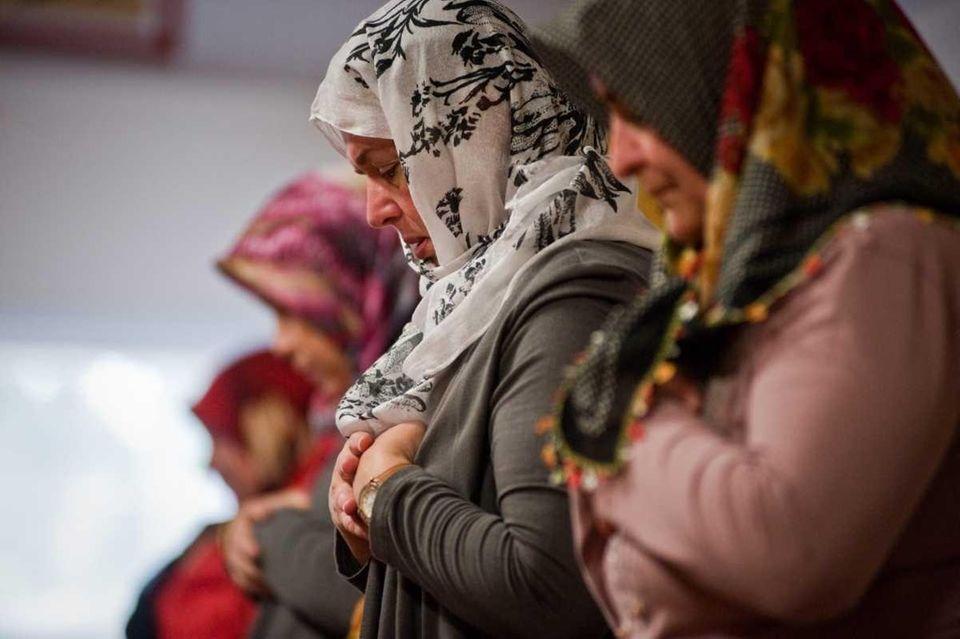 Muslims conduct prayer inside a center in Port