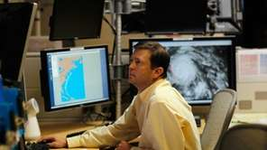 Senior Hurricane Specialist Daniel Brown studies computer models