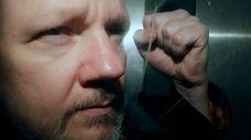 WikiLeaks founder Julian Assange being taken from court,