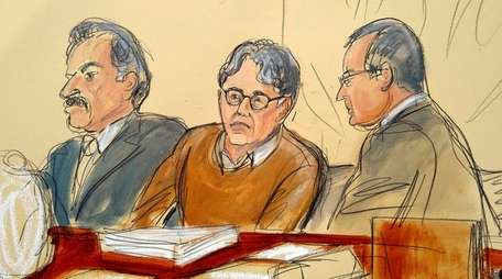 In this courtroom drawing, defendant Keith Raniere, center,