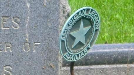 A veterans marker at a grave at All