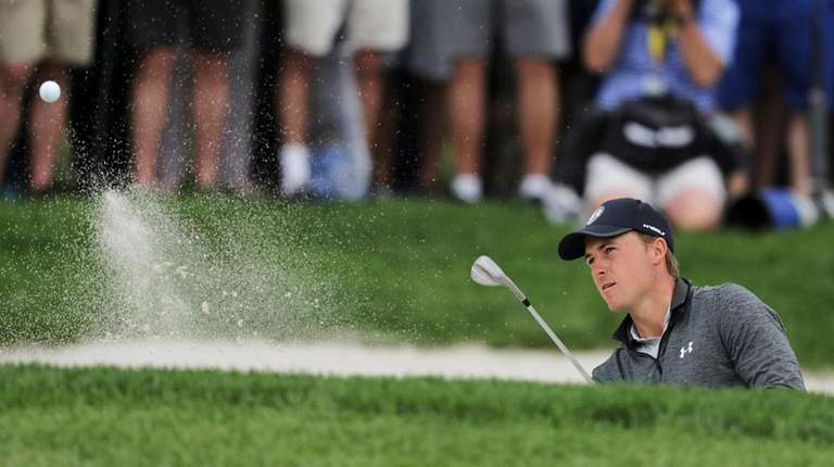 Jordan Spieth hits out of a bunker on
