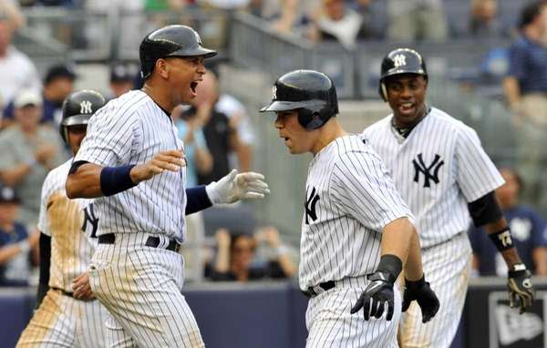 Alex Rodriguez and Russell Martin celebrate Martin's sixth