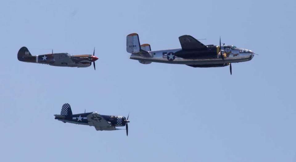 Vintage aircraft, American Airpower Museum Warbirds, perform during
