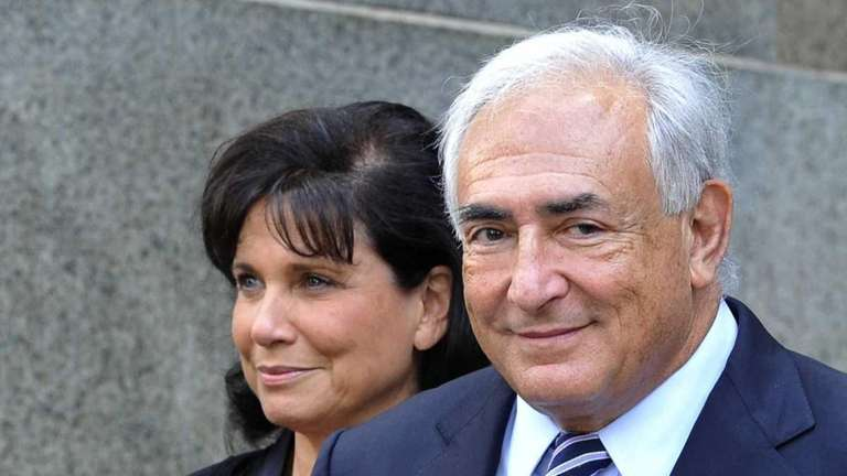Dominique Strauss-Kahn and his wife Anne Sinclair leaving