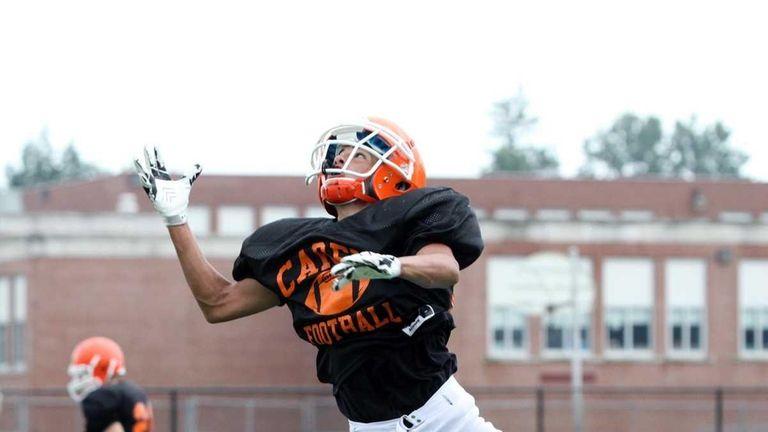 Carey's Joe Torregrossa leaps for the pass during