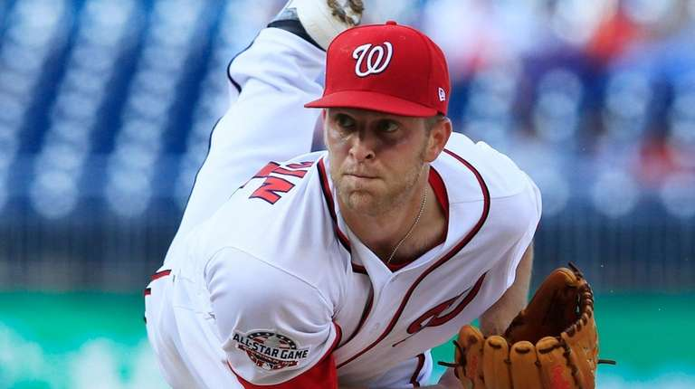 Nationals starter Kyle McGowin watches a pitch against