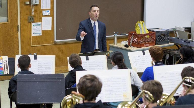 Music teacher Paul Lasurdo directs the Elwood Middle
