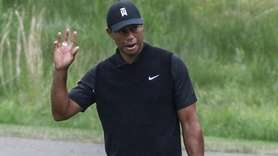 Tiger Woods acknowledges the crowd after sinking his