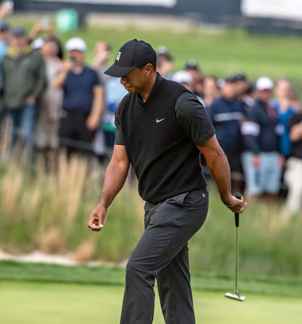 Tiger Woods reacts after missing and important putt