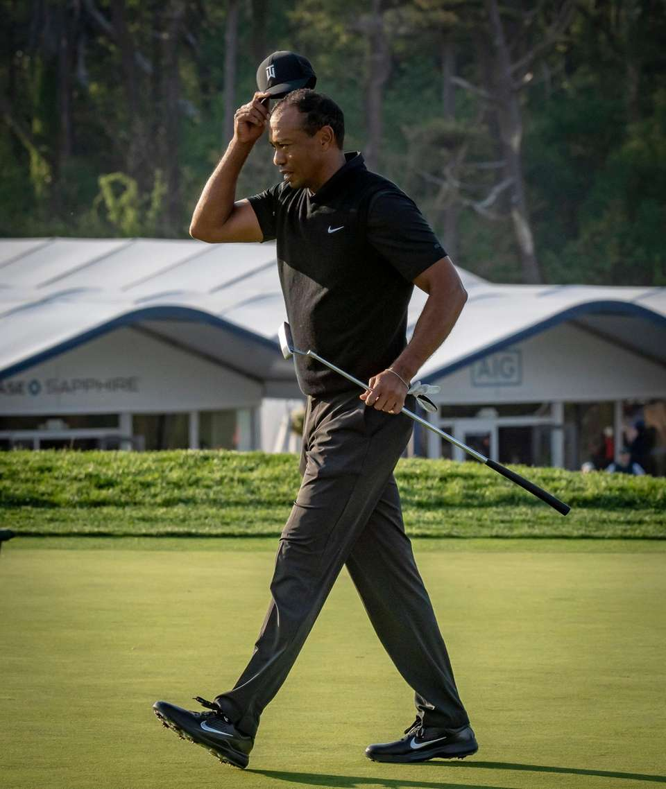 Tiger Woods reacts ending his quest in the