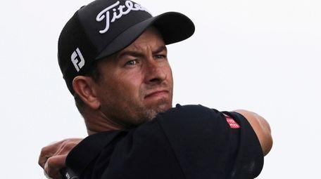 Adam Scott follows through on a tee shot