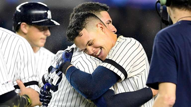 Gio Urshela of the Yankees is congratulated by