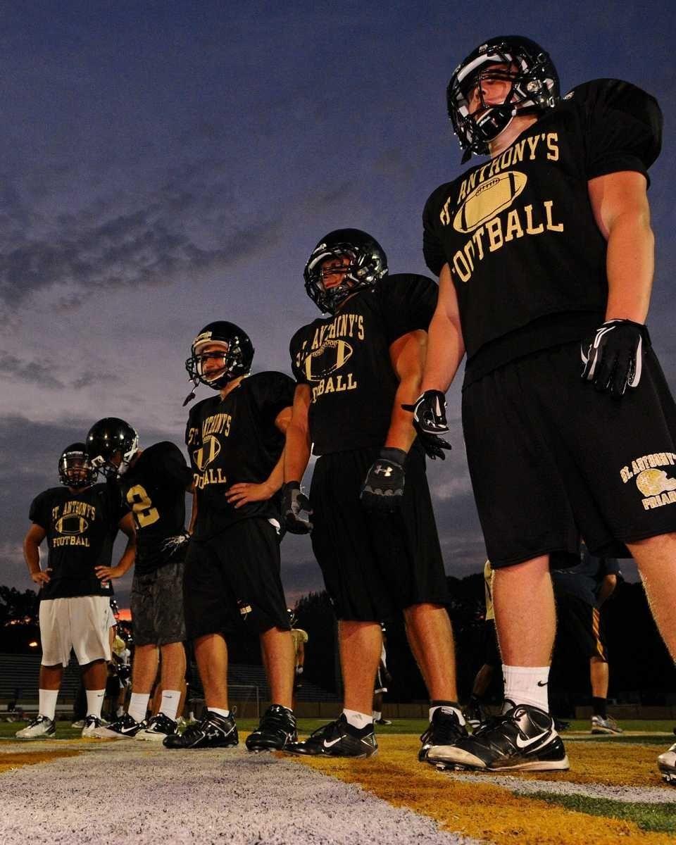 St. Anthony's High School's varsity football team practices