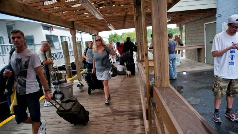 Residents from Fire Island Pines walk off the