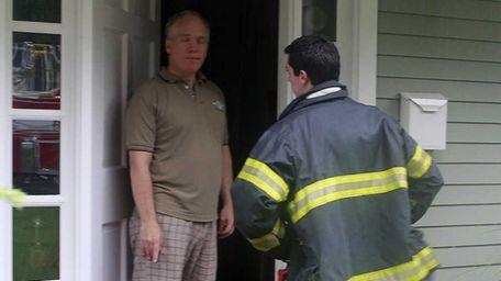 West Islip volunteer fireman Scott Filapazzo explains the