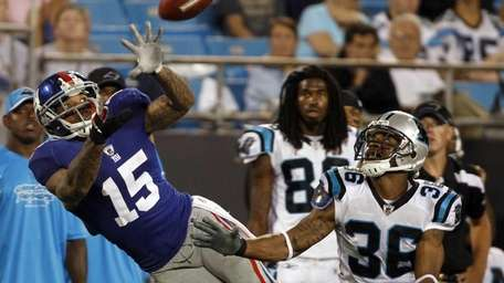 New York Giants' Devin Thomas reaches for a