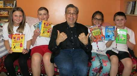 Author Chris Grabenstein with Kidsday reporters Julianna Kramer,