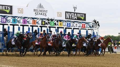 Horses leave the gate at the start of